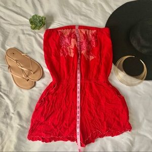 Red strapless romper